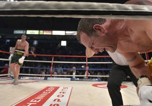 Martin Rogan struggles to get to his feet after being felled by Tyson Fury during their Irish Heavyweight title bout at the Odyssey Arena