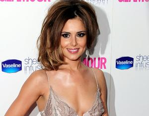 Cheryl Cole wins the Woman of the Year Award at the Glamour Women of the Year Awards in Berkeley Square, London.