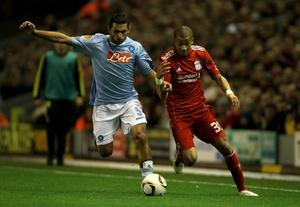 LIVERPOOL, ENGLAND - NOVEMBER 04:  Nathan Eccleston of Liverpool battles for the ball with Michele Pazienza of Napoli during the UEFA Europa League Group K match beteween Liverpool and SSC Napoli at Anfield on November 4, 2010 in Liverpool, England.  (Photo by Clive Brunskill/Getty Images)