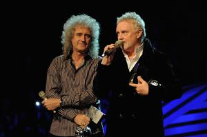 BELFAST, NORTHERN IRELAND - NOVEMBER 06:  Brian May (L) and Roger Taylor of Queen receive the award for Global Icon during the MTV Europe Music Awards 2010 live show at at the Odyssey Arena on November 6, 2011 in Belfast, Northern Ireland.  (Photo by Dave Benett/Getty Images)