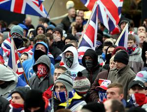 Loyalists in Belfast city centre for a protest against new restrictions on flying the Union flag