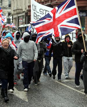 Protesters in Belfast city centre rally against new restrictions on flying the Union flag