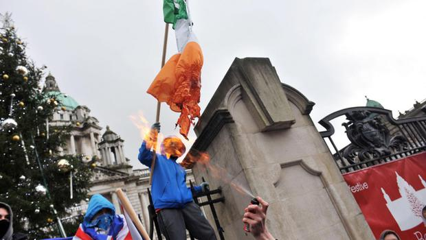 Loyalists converge on Belfast City Hall on Saturday afternoon to protest at the removal of the Union flag earlier this week