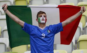 An Italy fan holds a national flag prior the Euro 2012 soccer championship Group C match between  Spain and Italy in Gdansk, Poland, Sunday, June 10, 2012
