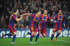 BARCELONA, SPAIN - MARCH 08:  Xavi Hernandez of Barcelona celebrates with team-mates David Villa and Andres Iniesta during the UEFA Champions League round of 16 second leg match between Barcelona and Arsenal at the Nou Camp Stadium on March 8, 2011 in Barcelona, Spain.  (Photo by Shaun Botterill/Getty Images)