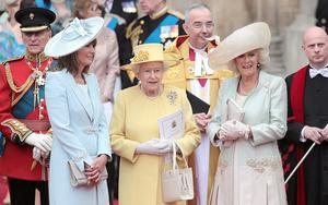 The Royal Wedding...Queen Elizabeth II is flanked by Carole Middleton (left)and Camilla, Duchess of Cornwall after the wedding ceremony Prince William and Kate Middleton at Westminster Abbey. PRESS ASSOCIATION Photo.
