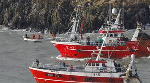 Trawlers and small boats search the shoreline at Union Hall in West Cork as the search continues for five people who went missing after the  Tit Bonhomme trawler struck rocks at the mouth of the harbour in the early hours of Sunday morning.