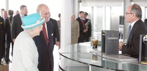 Queen Elizabeth II and the Duke of Edinburgh offered a pint of Guinness  at the Guinness Storehouse