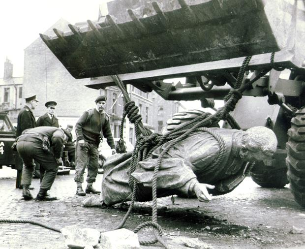 Army engineers take away the fallen statue of the famous Protestant minister The Rev 'Roaring Hugh Hanna'   after an early morning IRA bomb blast at Carlisle Circus.   3/3/1970