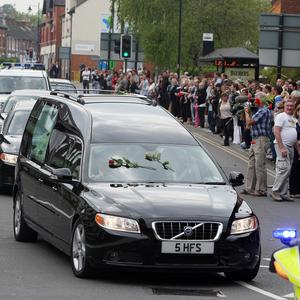 Crowds line the street as a hearse carrying the coffin of Sian O'Callaghan passes