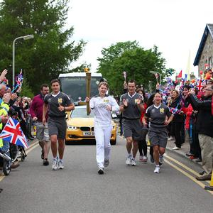 Abigail O'Grady carries the flame on the Torch Relay leg between Grantown-on-Spey and Tomintoul