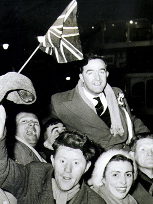 DESMOND BOAL IS HELD ALOFT BY JUBILANT UNIONIST SUPPORTERS AT THE BELFAST CITY HALL AS THE RESULT OF THE SHANKILL BY-ELECTION IS ANNOUNCED.     17/2/1960
