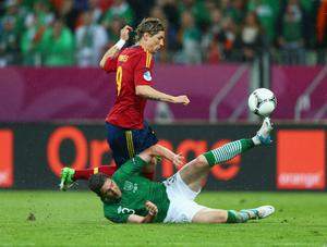 GDANSK, POLAND - JUNE 14: Stephen Ward of Republic of Ireland clashes with  Fernando Torres of Spain during the UEFA EURO 2012 group C match between Spain and Ireland at The Municipal Stadium on June 14, 2012 in Gdansk, Poland.  (Photo by Michael Steele/Getty Images)