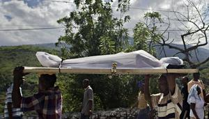 People carry a body through the streets on Wednesday Jan. 13, 2010 in Port-au-Prince