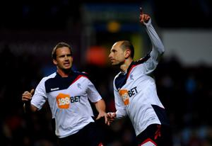 BIRMINGHAM, ENGLAND - APRIL 24:  Martin Petrov of Bolton Wanderers celebrates scoring his team's first goal from a penalty with team mate Kevin Davies (L) during the Barclays Premier League match between Aston Villa and Bolton Wanderers at Villa Park on April 24, 2012 in Birmingham, England.  (Photo by Laurence Griffiths/Getty Images)