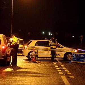 Gardai man a checkpoint near the scene where Detective Garda Adrian Donohoe died following a shooting incident