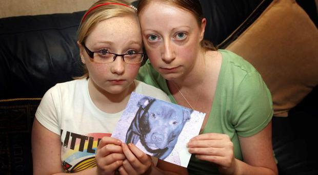Caroline Barnes and her 12year old daughter Brooke holding a picture of their dog Lennox. PACEMAKER BELFAST