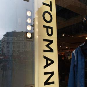 Retailer Topman has withdrawn two T-shirts after complaints over sexist slogans