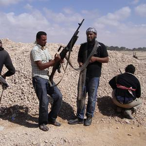 Libyan rebels say they are battling Gaddafi forces in a strategic town south-west of Tripoli (AP)