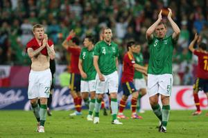 GDANSK, POLAND - JUNE 14:   James McClean  and Richard Dunne of Republic of Ireland appalud the fans after the UEFA EURO 2012 group C match between Spain and Ireland at The Municipal Stadium on June 14, 2012 in Gdansk, Poland.  (Photo by Alex Grimm/Getty Images)