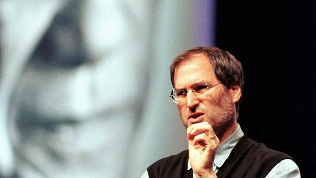FILE - In this Oct. 2, 1997, file photo, Steve Jobs of Apple Computer, speaks during the Seybold publishing conference in San Francisco, in front of a poster of artist Pablo Picasso from Apple's latest advertising campaign. Apple on Wednesday, Oct. 5, 2011 said Jobs has died. He was 56. (AP Photo/Thor Swift, File)