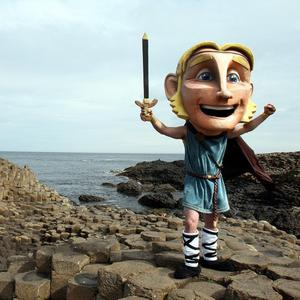 Fairytale giant Finn McCool stands at the Giant's Causeway, County Antrim, to mark the opening of the new visitors' centre