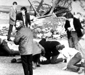 A man receiving attention during the shooting incident in Londonderry, Northern Ireland, which became known as Bloody Sunday,  January 31, 1972.
