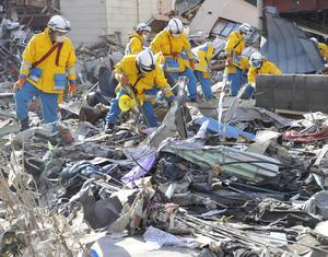 Police officers from Hyogo Prefecture search missing persons in the rubble in Kamaishi, Iwate Prefecture, northern Japan Monday, March 14, 2011 following Friday's massive earthquake and the ensuing tsunami. (AP Photo/Kyodo News)  JAPAN OUT, MANDATORY CREDIT, NO SALES IN CHINA, HONG  KONG, JAPAN, SOUTH KOREA AND FRANCE