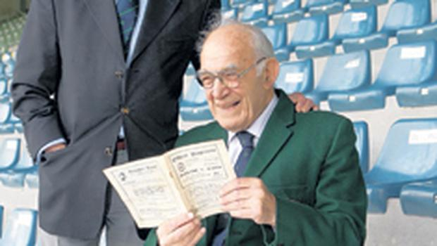 Ireland legends Jack Kyle (left) and Jimmy Nelson read the match programme from the famous 6-3 victory over Wales in 1948 at Ravenhill which clinched the Grand Slam