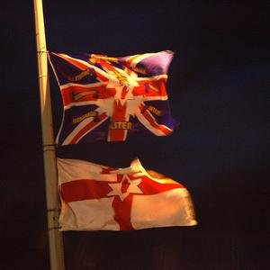 Leaving flags on display for too long can become 'a threatening attempt to mark territory', it is claimed