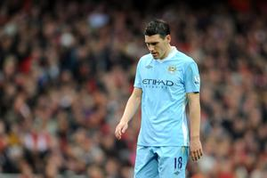 LONDON, ENGLAND - APRIL 08:  Gareth Barry of Man City looks dejected during the Barclays Premier League match between Arsenal and Manchester City at Emirates Stadium on April 8, 2012 in London, England.  (Photo by Michael Regan/Getty Images)