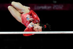 Great Britain's Beth Tweddle competes on the uneven bars during the Artistic Gymnastics Team Qualification at the North Greenwich Arena, London, on the second day of the London 2012 Olympics