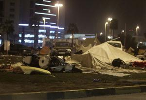 Anti-government demonstrators' damaged tents are seen at the Pearl roundabout in Manama, Bahrain, early Thursday morning, Feb. 17, 2011, after riot police attacked them. Riot police firing tear gas and rubber bullets stormed a landmark square occupied by anti-government protesters Thursday, driving out demonstrators and destroying a makeshift encampment that had become the hub for demands to bring sweeping political changes to the kingdom. (AP Photo/Hassan Ammar)