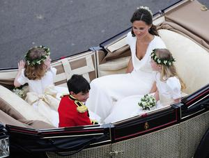 Pippa Middleton joins the procession to Buckingham Palace after the wedding ceremony between Prince William and his new bride Kate.PRESS ASSOCIATION Photo.   Picture date: Friday April 29, 2011.  See PA Story: WEDDING Lead. Photo credit should read:John Giles/PA Wire