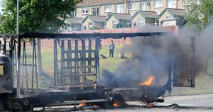 The scene in Lurgan, County Armagh after a number of vehicles were hijacked and set on fire and petrol bombs were thrown at police