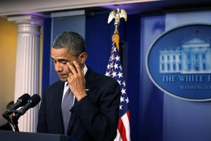WASHINGTON, DC - DECEMBER 14:  U.S. President Barack Obama wipes tears as he makes a statement in response to the elementary school shooting in Connecticut December 14, 2012 at the White House in Washington, DC. According to reports, there are 27 dead, including the shooter, 20 of them children, after Ryan Lanza, 24, opened fire in at the Sandy Hook Elementary School in Newtown, Connecticut. Reports say that Lanza was dead at the scene and his mother, a teacher at the school, is also dead. His brother has also been found dead in Hoboken, New Jersey.  (Photo by Alex Wong/Getty Images)