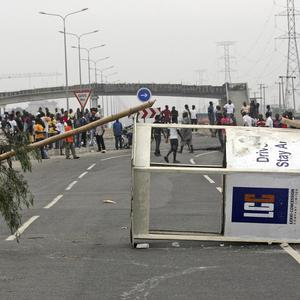 Angry protesters barricade roads on the third day of nationwide strike following the removal of a fuel subsidy by the government in Nigeria (AP)