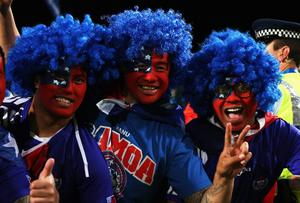 AUCKLAND, NEW ZEALAND - SEPTEMBER 30: Samoan fans show their colours during the IRB 2011 Rugby World Cup Pool D match between South Africa and Samoa at North Harbour Stadium on September 30, 2011 in Auckland, New Zealand.  (Photo by Sandra Mu/Getty Images)
