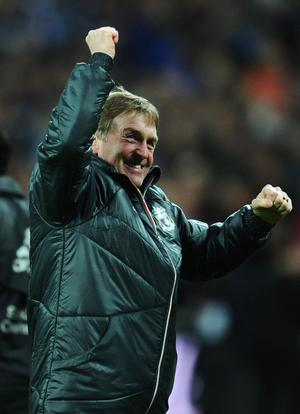 LONDON, ENGLAND - FEBRUARY 26:  Kenny Dalglish manager of Liverpool celebrates victory after the Carling Cup Final match between Liverpool and Cardiff City at Wembley Stadium on February 26, 2012 in London, England. Liverpool won 3-2 on penalties.  (Photo by Mike Hewitt/Getty Images)