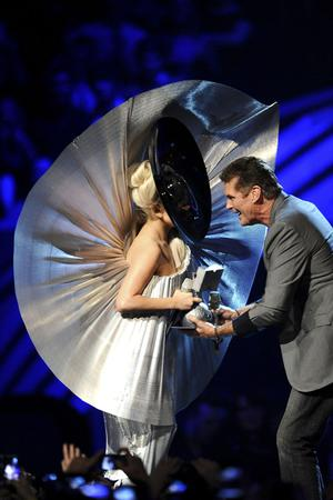 BELFAST, NORTHERN IRELAND - NOVEMBER 06:  Singer Lady Gaga receives the award for Best Female from actor David Hasselhoff onstage during the MTV Europe Music Awards 2010 live show at at the Odyssey Arena on November 6, 2011 in Belfast, Northern Ireland.  (Photo by Ian Gavan/Getty Images)