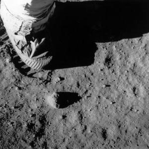 <b>Footprints require moisture </b><br/>  The footprints made in the dust on the moon would require moisture to make - try it with sand.  Well, you could also try it with talcum powder, which doesn't require moisture to retain a footprint and bears much more resemblance to the fine grain of moon dust.