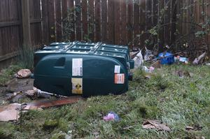 An oil tank lies on its side after the flooding at Bealaghmor