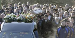 Michaela McAreavey's coffin is carried from her parents' home in Ballygawley, Co Tyrone