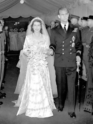 File photo dated 20/11/1947 of Princess Elizabeth, now Queen, and the Duke of Edinburgh leaving Westminster Abbey on their wedding day. PRESS ASSOCIATION Photo.