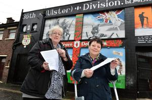 Jean Barnes and Roberta McCartney read the anti-violence leaflet being distributed around east Belfast
