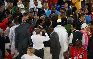 Jamaica's Usain Bolt is mobbed by the other athletes at the Opening Ceremony at the Olympic Stadium, London. PRESS ASSOCIATION Photo. Picture date: Friday July 27, 2012. See PA story OLYMPICS Ceremony. Photo credit should read: Mike Egerton/PA Wire. EDITORIAL USE ONLY