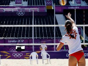 LONDON, ENGLAND - JULY 26:  A Spanish volleyball player practices during a beach volleyball practice session ahead of the London 2012 Olympics at Horse Guards Parade on July 26, 2012 in London, England.  (Photo by Streeter Lecka/Getty Images)