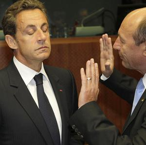 Under-pressure French President Nicolas Sarkozy at a summit in Brussels