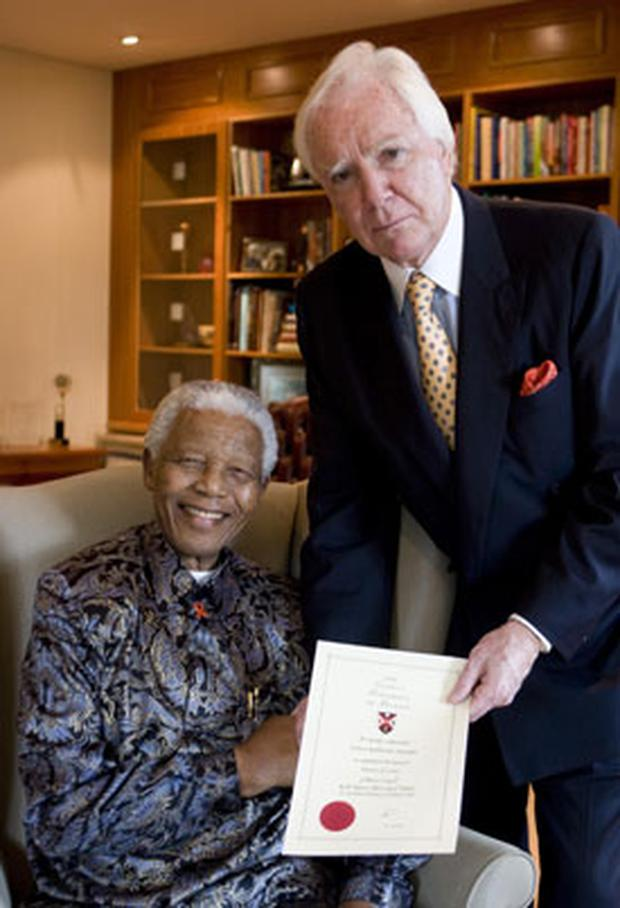 Nelson Mandela receives his honorary doctorate from Sir Anthony O'Reilly