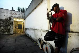 SALVADOR, BRAZIL - FEBRUARY 16: A musician rests after performing on the first day of Carnival celebrations on February 16, 2012 in Salvador, Brazil. Carnival is the grandest holiday in Brazil, annually drawing millions in raucous celebrations culminating on Fat Tuesday before the start of the Catholic season of Lent which begins on Ash Wednesday. Salvador is the capital of the Northeastern state of Bahia and was the first colonial capital of Brazil. Police strikes in Salvador and Rio de Janiero in recent weeks threatened Carnival and raised questions about the countryÄôs preparedness to host the upcoming 2014 World Cup and 2016 Summer Olympics. Rio de JanieroÄôs Carnival begins tomorrow.   (Photo by Mario Tama/Getty Images)